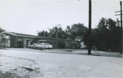 Black's Store, shown here circa 1969, was owned by Charles Black.  It had four apartments, a dry cleaners, and a beauty parlor, along with a store that sold groceries and snacks. With a lunch counter and juke box, the establishment became a popular place for teens to gather, eat, dance, and enjoy being together.